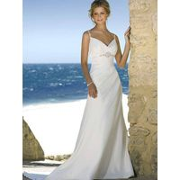 Beach wedding gown features in satin and drapes in a modified silhouette thumbnail image