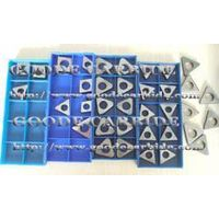 Tungsten carbide shims for cutting inserts