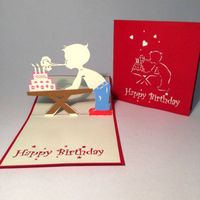A boy blowing birthday candles 3D pop up greeting card