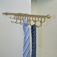 Wardrobe side mount pull out tie rack
