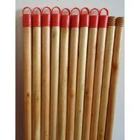 varnished wooden broom handle