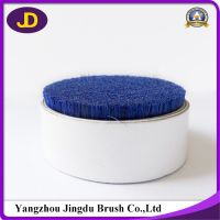 The manufacturer recommends the blue hard and short cutting natural bristle.
