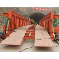 Wheeled hydraulic inverting bridge formwork