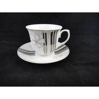 silver decal tea cup and saucer