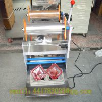 A two Semi - automatic box-sealing machine round box a two sealer a four Sealer automatic cup sealin