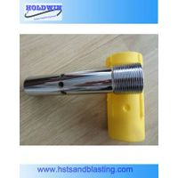Double venturi tungsten carbide nozzle with a holder