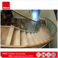 curved staircase with glass railing