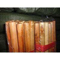 varnished wooden broom stick handle