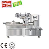 Automatic Disc feeding hard boiled hard candy sweety pillow packing machine flow wrapper equipment